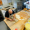 Randy Delrymple places doughnut sticks onto a sheet at Bolin's Donuts in Logansport on Friday, Oct. 8, 2021.