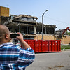 Dahrol Perry, communications director for the mayor, takes video of the Logansport Municipal Utilities water treatment plant roof being torn down in Logansport on Thursday, July 29, 2021.
