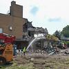 Glynn's Demolition employees continue demolishing the Logansport Municipal Utilities water treatment plant in Logansport on Thursday, July 29, 2021.