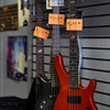 A few bass guitars hang on the racks at Pulse Music during its closing sale in Logansport on Thursday, Sept. 30, 2021. More popular items, like right-handed guitars, sold out.