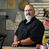 Manager Scott Cress stands behind the counter at Pulse Music in Logansport on Thursday, Sept. 30, 2021. The store is closing after 25 years of business. Cress has been the manager since 2007.