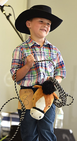 Kevin Burkett | Pharos-Tribune<br /> <br /> Isiah Wamsley, 5, reacts to the crowd before being selected as the 2017 Little Mr. Cowboy on Wednesday, July 12, 2017. The Eastern Pulaski student's parents are Kent and Anne.