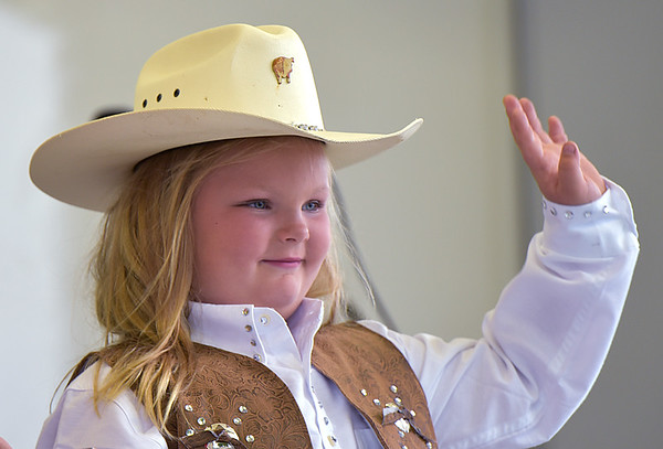Kevin Burkett | Pharos-Tribune<br /> <br /> Riggin Goings, 6, waves to the crowd before being selected as the 2017 Little Miss Cowgirl on Wednesday, July 12, 2017. The Pioneer student's parents are Nick and Rachel.