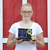 Kevin Burkett | Pharos-Tribune<br /> <br /> Esther McKaig took home the prize for Master Showman in the dairy female show on Thursday, July 14, 2017.
