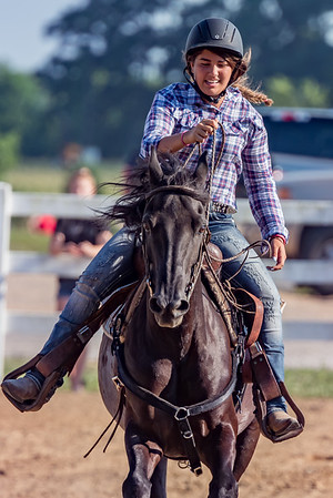 Gianna Rozzi, 14, and her horse Cruiser finish the poles competition in the horse and pony competition on Monday night at the Cass County Fair. Fran Ruchalski | Pharos-Tribune