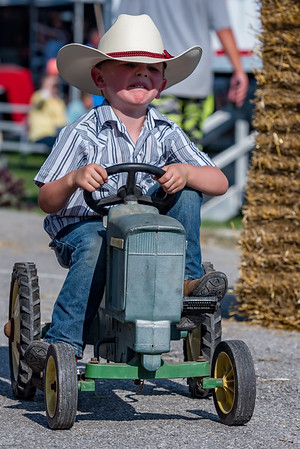 Four-year-old Carver Dodt pedals as best he can during the pedal tractor races on Monday afternoon at the Cass County Fair. Fran Ruchalski | Pharos-Tribune