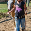 Eleven-year-old Emilia Rozzi walks her horse Nova around the practice ring to get ready to ride in the horse and pony competition on Monday night at the Cass County Fair. Fran Ruchalski | Pharos-Tribune