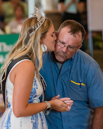 Tommy Hook gets a kiss from Miss Cass County McKayla Ramsey at the Cass County 4-H Livestock Auction on Saturday afternoon. The Queen's Kiss brought $2792 at the auction. Fran Ruchalski | Pharos-Tribune