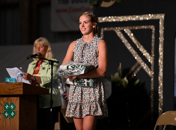 Olivia Brooke is recognized as a 4-H tenure member during the opening day of the Cass County Fair in Logansport on Sunday, July 11, 2021.