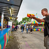 Brandon Moore, 21, of Logansport plays a carnival game during the opening day of the Cass County Fair in Logansport on Sunday, July 11, 2021.