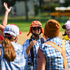 The Logan Lumberjacks prepare for a slow pitch softball game during the annual Fourth of July festival at Riverside Park in Logansport on Sunday, July 4, 2021.