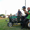 Daryl Wilder puts his helmet on before he competes in the garden tractor pull during Pioneer Days festivities at Rea Park on Friday, June 18, 2021 in Royal Center.