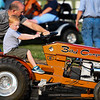 A dad and son prepare for the garden tractor pull during Pioneer Days festivities at Rea Park on Friday, June 18, 2021 in Royal Center.
