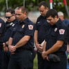 Members of the Cass County Fire District 1 bow their heads during a 9/11 remembrance 5K run and dog walk event hosted by the Logansport Police Department at Huston Park in Logansport on Saturday, Sept. 11, 2021.