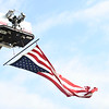 A large flag blows in the wind during a 9/11 remembrance 5K run and dog walk event hosted by the Logansport Police Department at Huston Park in Logansport on Saturday, Sept. 11, 2021.