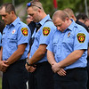 Members of the Logansport Fire Department bow their heads during a 9/11 remembrance 5K run and dog walk event hosted by the Logansport Police Department at Huston Park in Logansport on Saturday, Sept. 11, 2021.