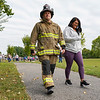 A firefighter walks wearing his gear during a 9/11 remembrance 5K run and dog walk event hosted by the Logansport Police Department at Huston Park in Logansport on Saturday, Sept. 11, 2021.
