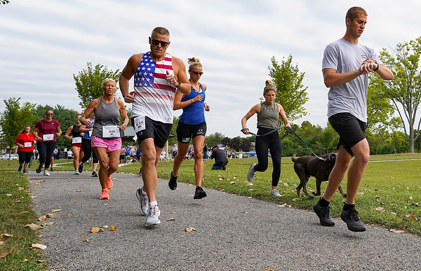 Participants begin running during a 9/11 remembrance 5K run and dog walk event hosted by the Logansport Police Department at Huston Park in Logansport on Saturday, Sept. 11, 2021.