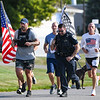5K participants, including police Chief Travis Yike and patrolman Branson Ebers run during a 9/11 remembrance 5K run and dog walk event hosted by the Logansport Police Department at Huston Park in Logansport on Saturday, Sept. 11, 2021.