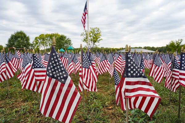 Flags for first responders who died responding to the Sept. 11 attacks are planted in the ground during a 9/11 remembrance 5K run and dog walk event hosted by the Logansport Police Department at Huston Park in Logansport on Saturday, Sept. 11, 2021.
