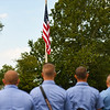 Firefighters look toward the flag while Taps plays during a 9/11 remembrance 5K run and dog walk event hosted by the Logansport Police Department at Huston Park in Logansport on Saturday, Sept. 11, 2021.