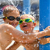 Grant Gangloff and Wyatt Hayden play at the Muehlhausen Park splash pad in Logansport on Wednesday, July 28, 2021.