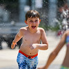 Abe Nolte laughs as he runs through the Muehlhausen Park splash pad in Logansport on Wednesday, July 28, 2021.