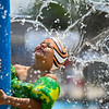 Jadyn Diaz hugs a portion of the Muehlhausen Park splash pad as cold water sprays around him in Logansport on Wednesday, July 28, 2021.