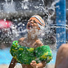 Jadyn Diaz reacts to water falling on him at the Muehlhausen Park splash pad in Logansport on Wednesday, July 28, 2021.