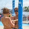 Children play at the Muehlhausen Park splash pad in Logansport on Wednesday, July 28, 2021.