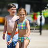 Avery Brown goes to play with a water spout at the Muehlhausen Park splash pad in Logansport on Wednesday, July 28, 2021.
