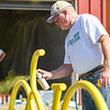 Tom Partridge touches up the paint on a bike rack during a Live United Day project at Steinberger Construction in Logansport on Friday, Sept. 10, 2021.
