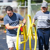A.J. Zimmerman and Laramie Kitchel carry a bike rack so it can be repainted during a Live United Day project at Steinberger Construction in Logansport on Friday, Sept. 10, 2021.