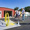 A.J. Zimmerman assists Tom Partridge as he touches up the paint on a bike rack during a Live United Day project at Steinberger Construction in Logansport on Friday, Sept. 10, 2021.