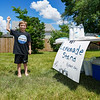Oliver Stillabower waves to attract some cars to his lemonade stand on Thursday, June 10, 2021 in Logansport.