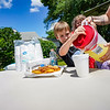 Oliver Stillabower, 7, center, pours his first cup of lemonade on Thursday, June 10, 2021 in Logansport. Stillabower had the idea for the stand to make himself some money during the summer.