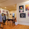 Members of the Logansport Art Association discuss some fo the pieces from the association's Myanmar exhibit at 424 Front St. in Logansport on Thursday, Sept. 23, 2021.