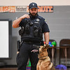 Officer Cody Scott and K-9 Snupy make eye contact during a presentation to students at Columbia Elementary School in Logansport on Tuesday, Sept. 21, 2021.