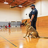 Officer Cody Scott and K-9 Snupy stand in the gymnasium at Columbia Elementary School in Logansport on Tuesday, Sept. 21, 2021.