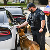 Officer Cody Scott prepares to load Snupy back into the car after a presentation at Columbia Elementary School in Logansport on Tuesday, Sept. 21, 2021.