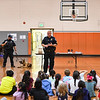 From left: Officer Cody Scott with his K-9 Snupy, Sgt. Dan Frye and Cpl. DJ Sommers speak to students at Columbia Elementary School in Logansport on Tuesday, Sept. 21, 2021.