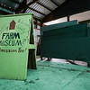The old farm museum sign sits near the voting machine at the Cass County 4-H Farigrounds in Logansport on Friday, Aug. 20, 2021.