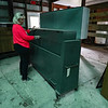 Cass County Extension Director Lynn Korniak shows an old voting machine found at the Cass County 4-H Farigrounds in Logansport on Friday, Aug. 20, 2021.