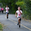 Runners race to the finish line during the River Bluff Fun Run and Walk at the River Bluff Trail in Logansport on Saturday, Oct. 2, 2021.