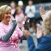 A breast cancer survivor goes to high five other survivors during the River Bluff Fun Run and Walk at the River Bluff Trail in Logansport on Saturday, Oct. 2, 2021.
