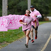 Olivia Gibson, 13, passes her dad, Josh, 38, as they head for the finish line during the River Bluff Fun Run and Walk  at the River Bluff Trail in Logansport on Saturday, Oct. 2, 2021. Josh Gibson said the event was a good way to spend time with his daughter who runs cross country at Logansport Junior High School.