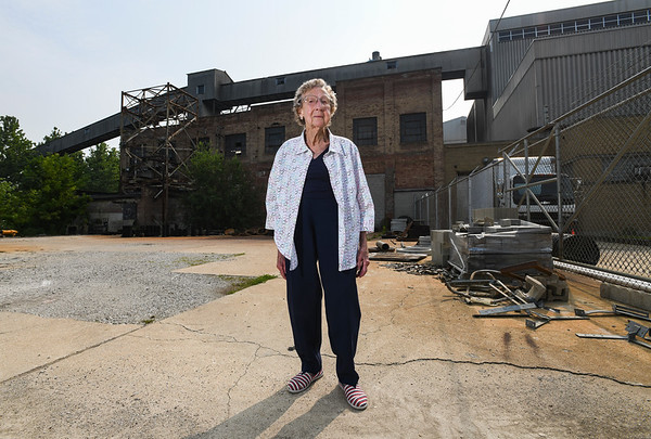 Ruth Quinn stands in front of the area her husband worked on, including the coal conveyor belt, at the Logansport Municipal Utilities Plant in Logansport on Friday, July 23, 2021.