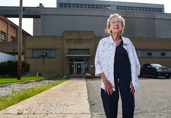 Ruth Quinn poses in front of the entrance of the Logansport Municipal Utilities Plant in Logansport on Friday, July 23, 2021.