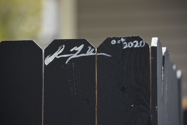 The signature of Indiana University student Sienna Urbina appears on the mural she painted on a fence on Wednesday, Oct. 28, 2020 in Logansport, Indiana.<br /> Jonah Hinebaugh   Pharos-Tribune