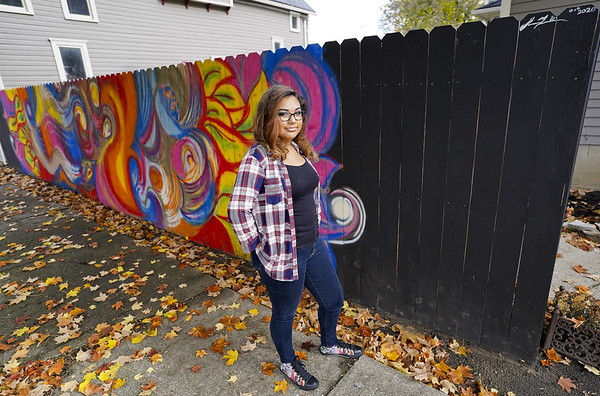 Indiana University Fine Art student Sienna Urbina, 20, poses in front of a mural she painted on a fence on Wednesday, Oct. 28, 2020 in Logansport, Indiana.<br /> Jonah Hinebaugh | Pharos-Tribune